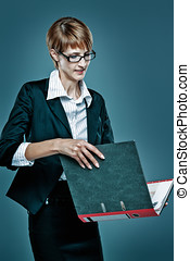 Smart business woman handling a folder with documents