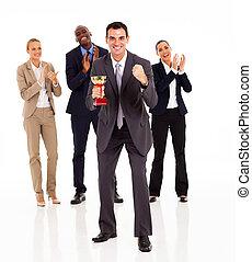 businessman and team winning a trophy