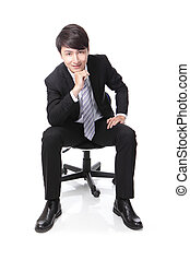 businessman smiling while sitting