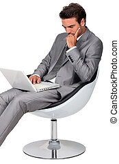 Smart businessman using laptop
