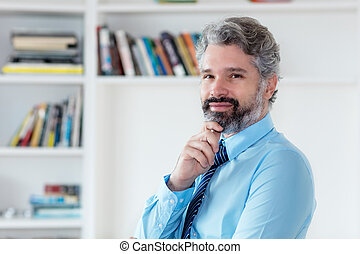 Smart businessman with grey hair and necktie