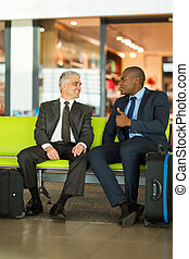 businessmen sitting at airport