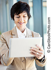 smart businesswoman using tablet computer