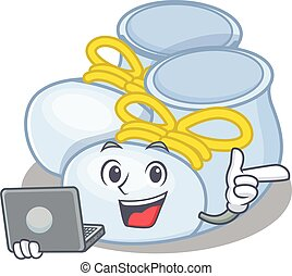 Smart cartoon character of baby boy boots studying at home with a laptop