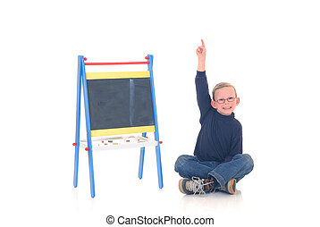 Smart child in classroom - Young boy casual dressed, in...