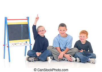 Smart children - Young boys casual dressed, in classroom,...