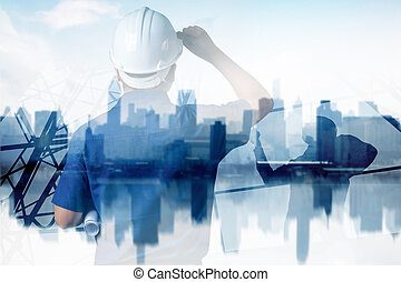 smart city and high construction development concept, double exposure engineer touching helmet to looking forward with city
