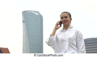 Smart city businesswoman talking on a mobile phone