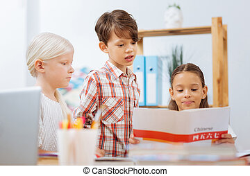 Smart classmates spending time together at home