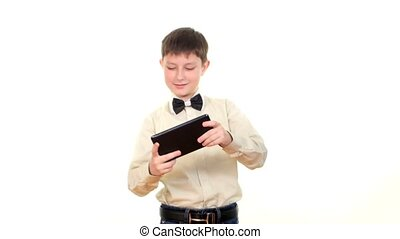 Smart, clever school boy playing using tablet computer, on white background
