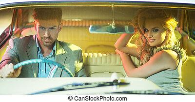 Smart couple riding the retro car