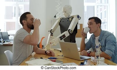 Smart coworkers having exciting talk - Robots ruling the...