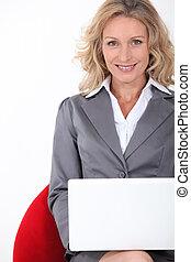 Smart executive woman using a laptop computer