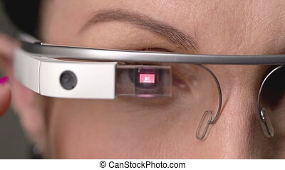 Extreme close up of female%u2019s eyes and data popping up on the smart glasses