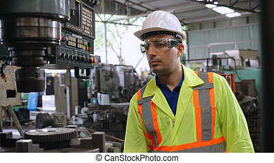 Smart factory worker using machine in factory workshop