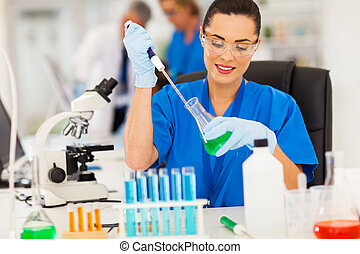 lab technician handling liquid in lab