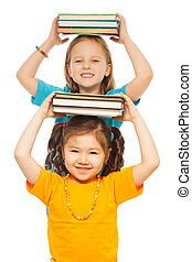 Smart girls with pile of books