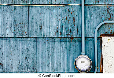 Smart grid power supply meter on grungy blue wall - Modern...