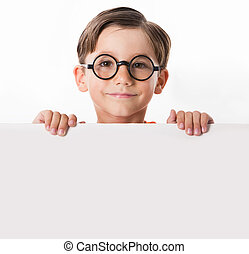 Smart guy - Face of youthful boy in glasses looking from...