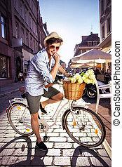 Smart guy riding a retro bike