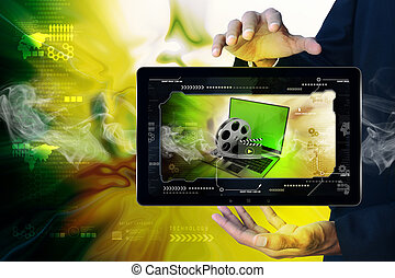 Smart hand showing Laptop with reel in frame