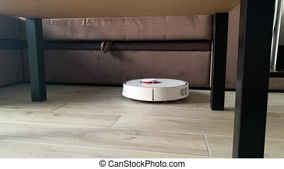 Smart home. Robot vacuum cleaner performs automatic cleaning...