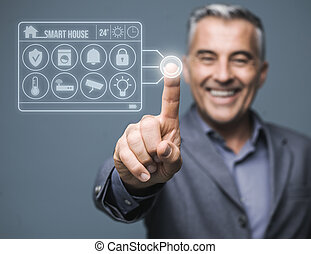 Confident man monitoring his smart house using a virtual touch screen interface system, home automation concept