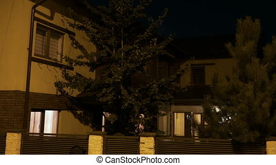 Smart house with pine trees from residential neighborhood...