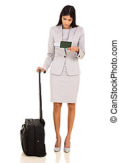 indian business woman looking at air ticket