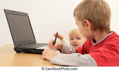 Smart kids - Two small children understand as the laptop...