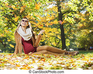 Smart lady watching autumn leaves