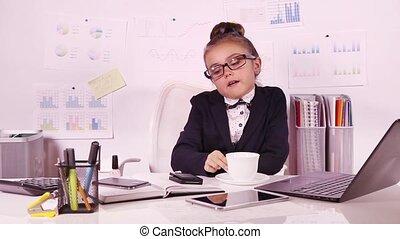 Smart little girl doing manicure - Smart little business...
