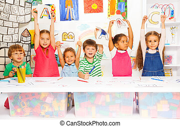 Smart little kids learning letters and writing