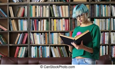 Smart looking female student reading in library