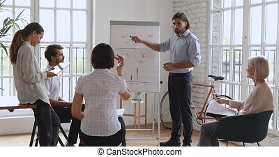 Smart male business trainer conducting educational ...
