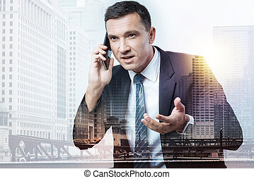 Smart man having business negotiations on the phone