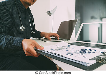 smart medical doctor working with smart phone and digital tablet and laptop computer and stethoscope on wood desk in modern office