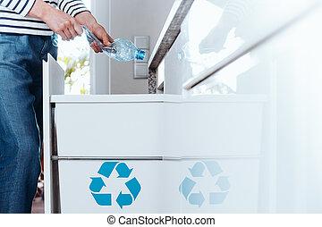 Smart person sorting plastic packagings