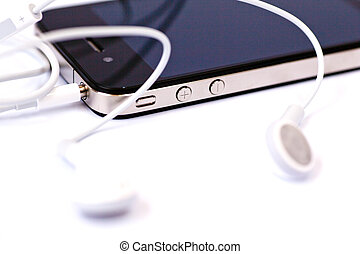 Smart phone and headphones isolated on a white background