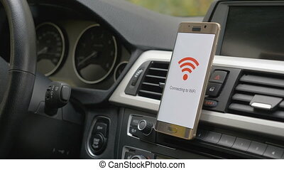 smart phone connects to wifi in car - a smart phone on the...