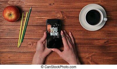Smart phone displaying YOU WON on screen