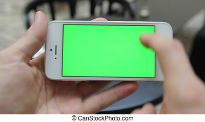 Smart Phone Held by Hand Green screen Chroma Key Tracking Motion Horizontal. Person Sitting Telephone on the Hand Swipe Down-Up Animation Type Zoom