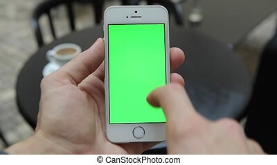 Smart Phone Held by Hand. Green screen Chroma Key Tracking Motion Vertical. Person Sitting Telephone on the Hand Swipe Down-Up Animation