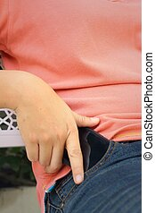 Smart phone in jeans pocket with pink shirt
