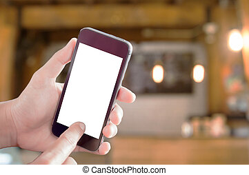 Smart phone in woman hand with coffee shop