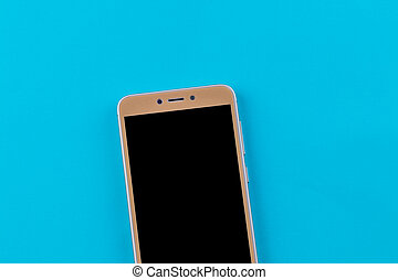 Smart phone on blue background. Top view