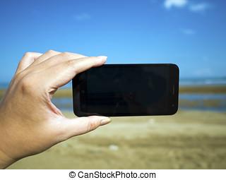 smart phone on hand