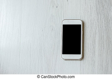 Smart phone on wooden  gray background with copy space