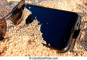 Smart phone sand vacation beach