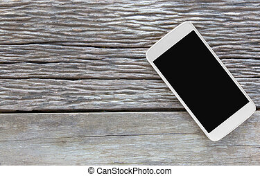smart phone, tablet, cellphone on wooden table background with copy space, top view